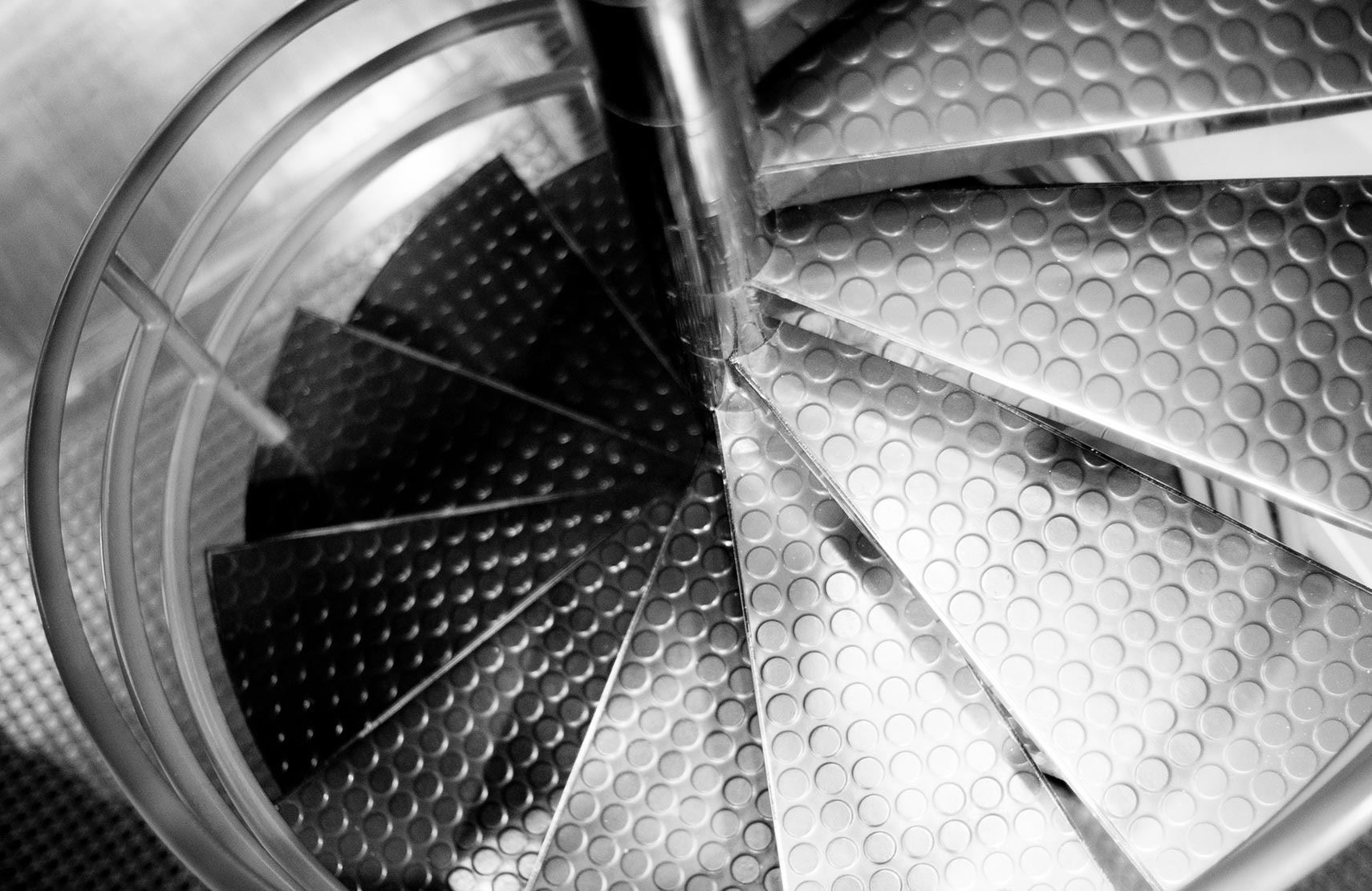 The spiral staircase in Sametz Blackstone Associates in black and white