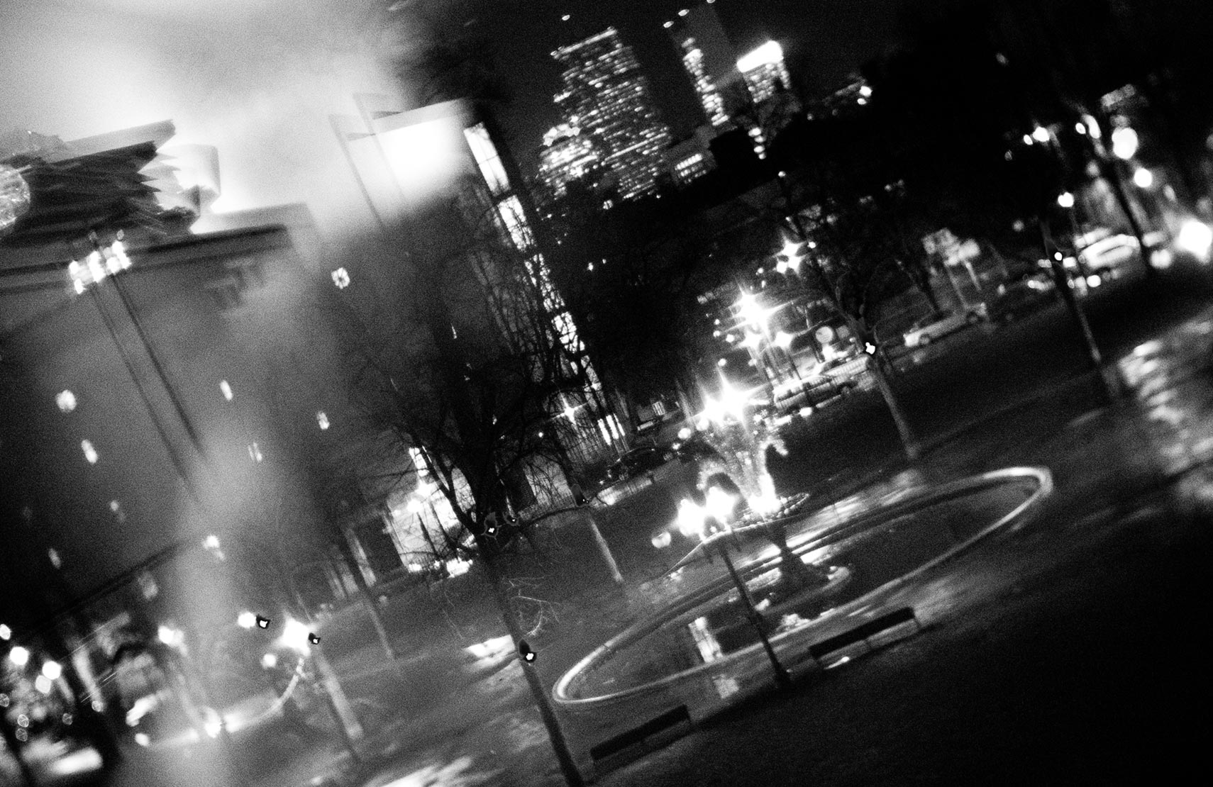 View of Blackstone Square at night from Sametz Blackstone Associates in black and white