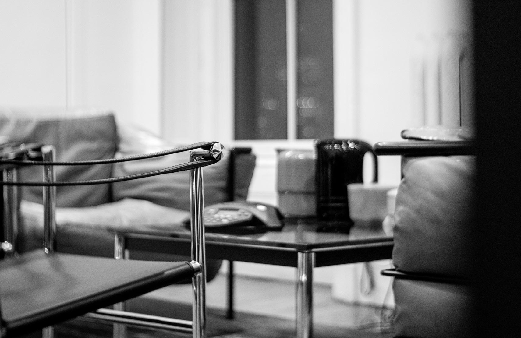 Table and chairs in Roger Sametz's office in black and white
